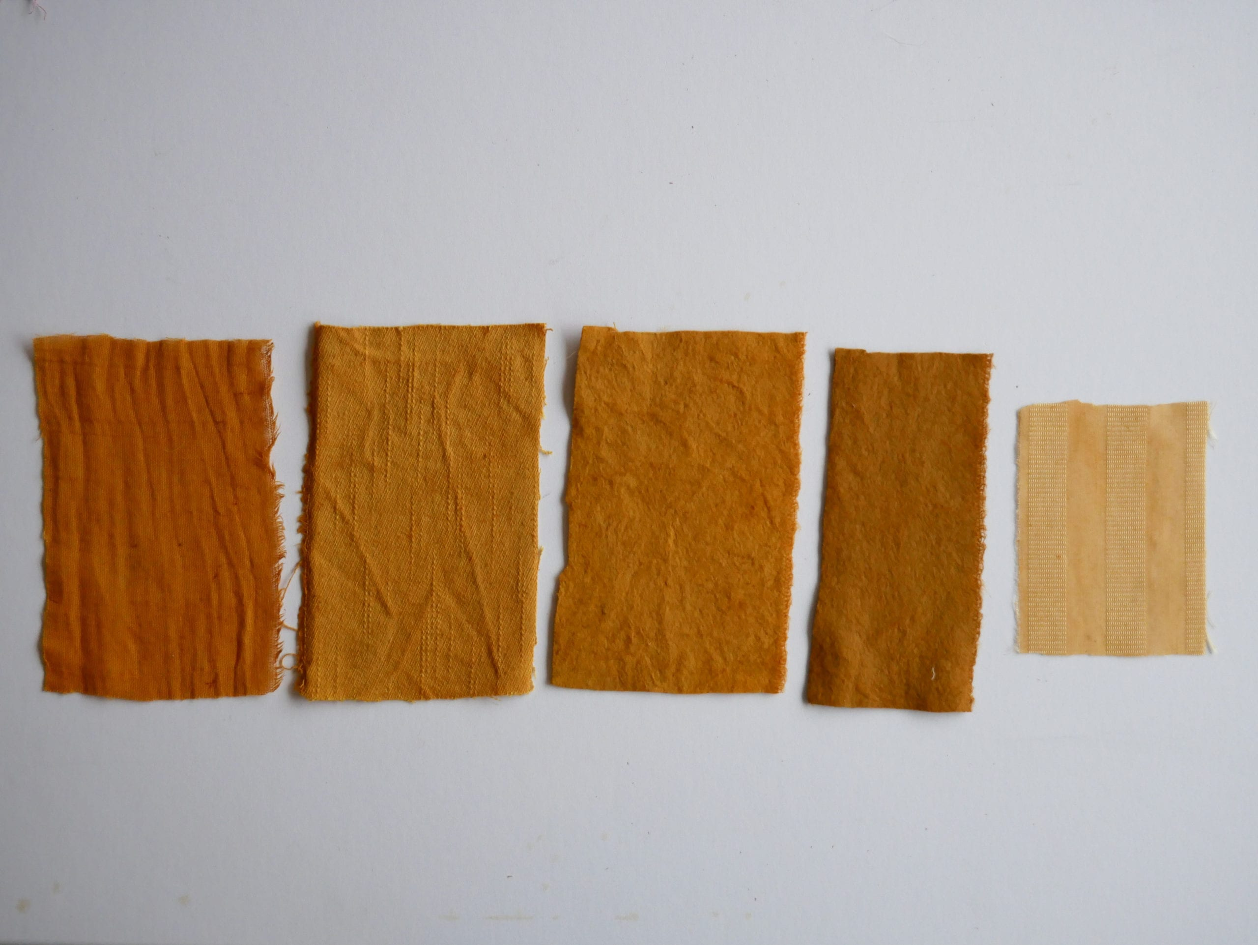 Onion skin natural dye samples on different substrates