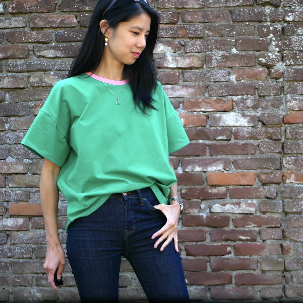 Green version of the Just Patterns Tyra Tee with a pink neckband.