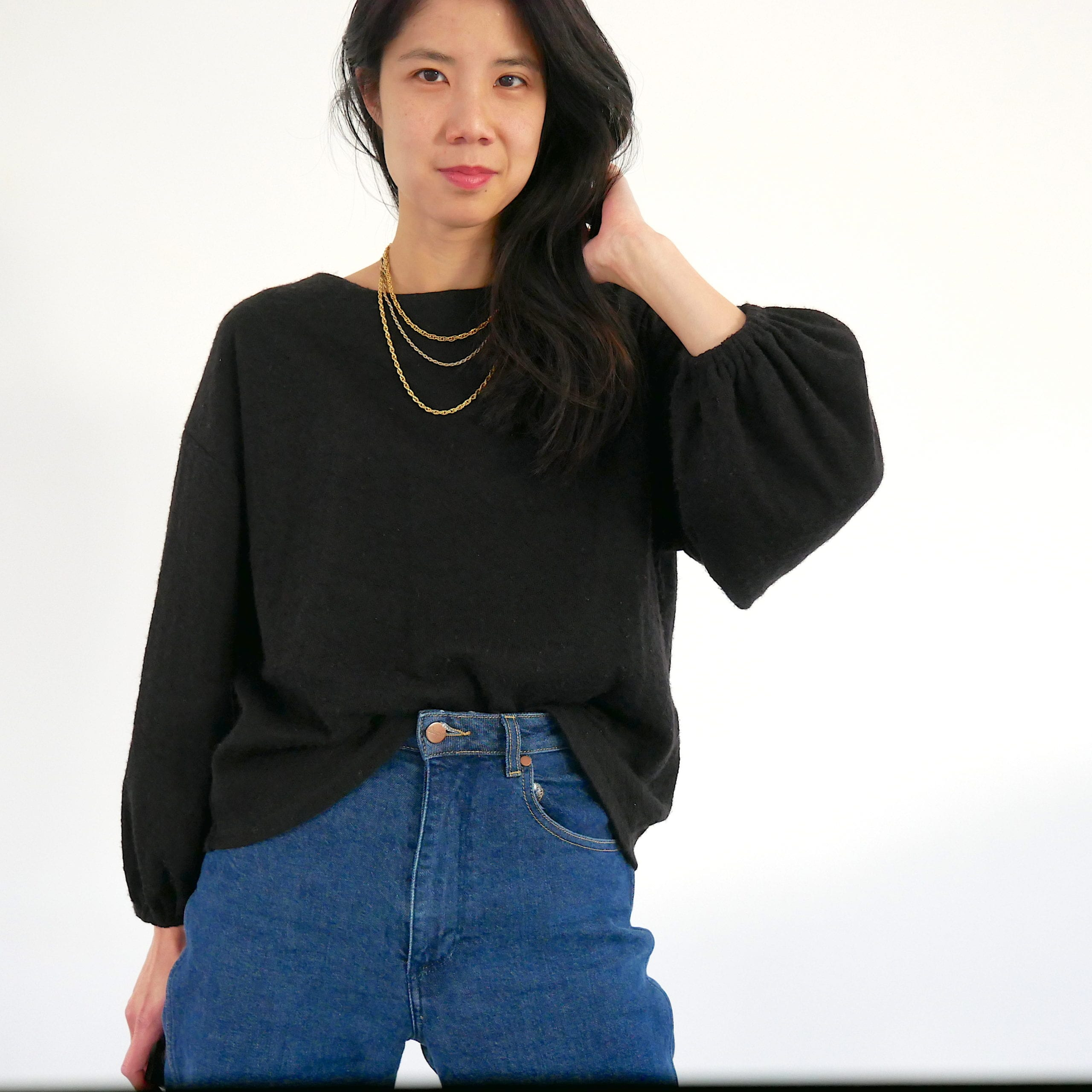Black Just Patterns Tyra sweater by Time to Sew worn with a gold necklace stack and mom jeans