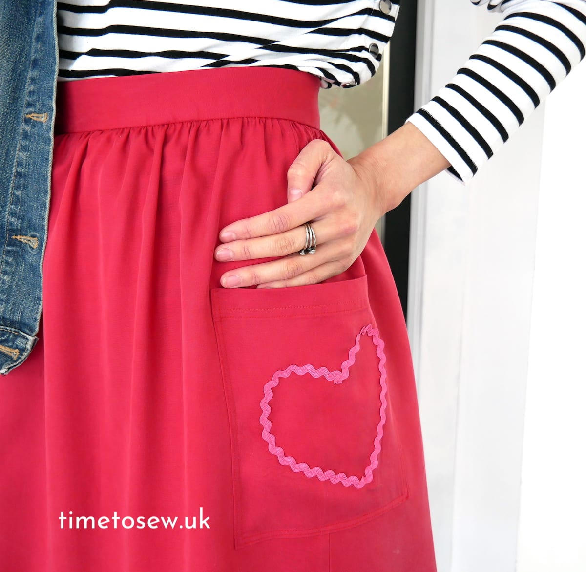 Close up of red gathered skirt with pink heart by Time to Sew