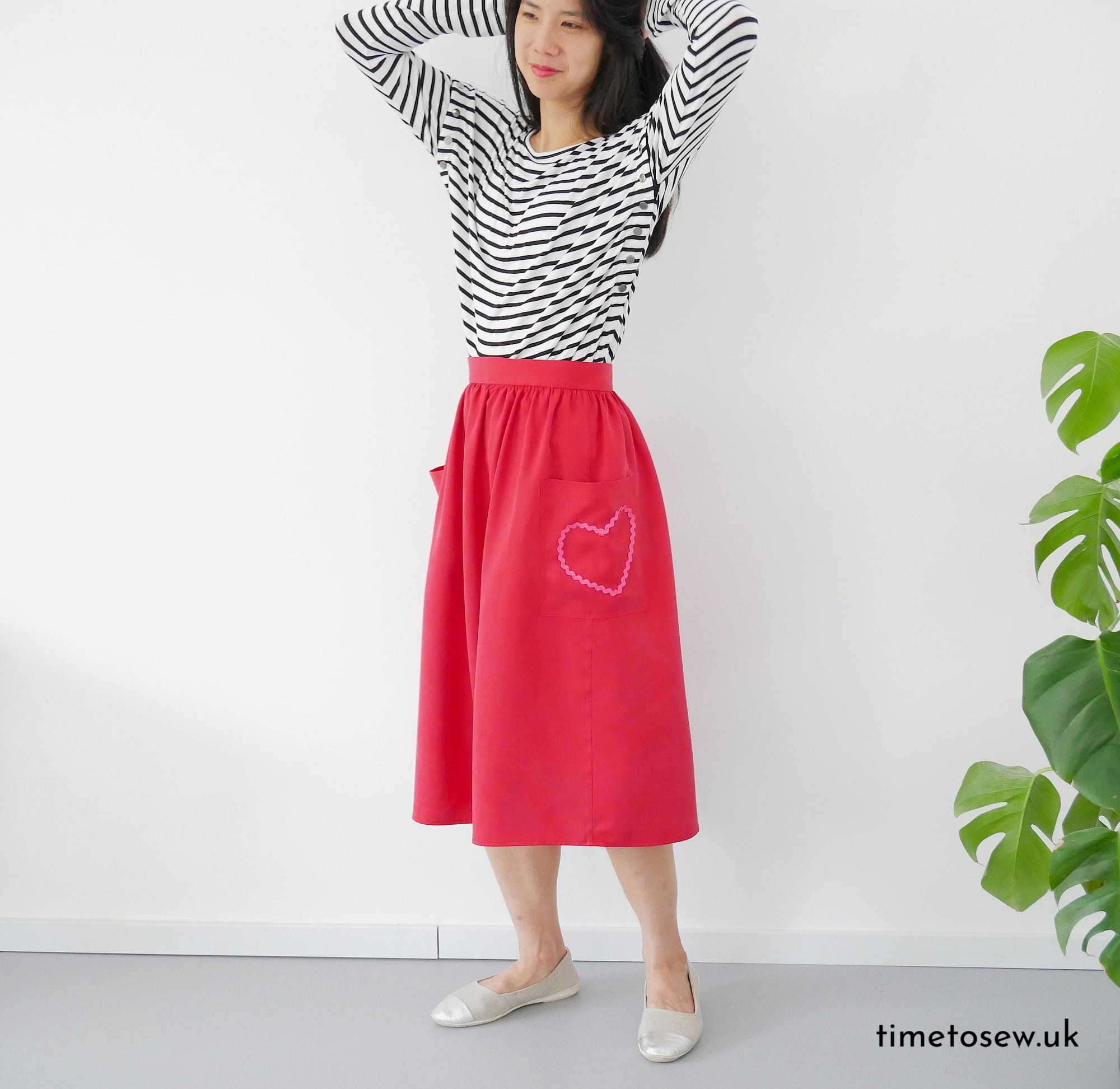 Red gathered skirt with pink heart by Time to Sew worn with stripey top