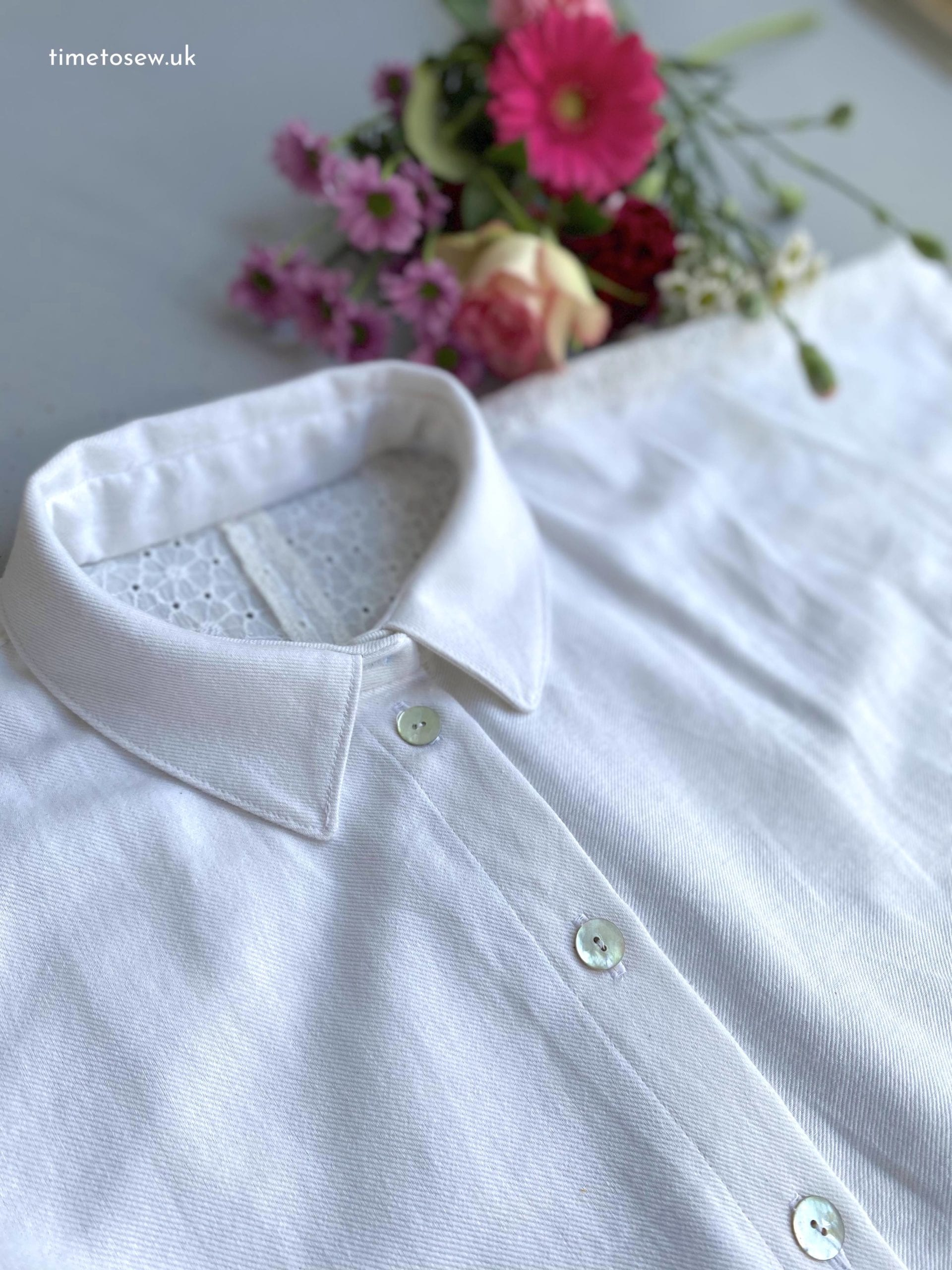 Close up of collar and buttons of Fibre Mood Aila, a white button down shirt.