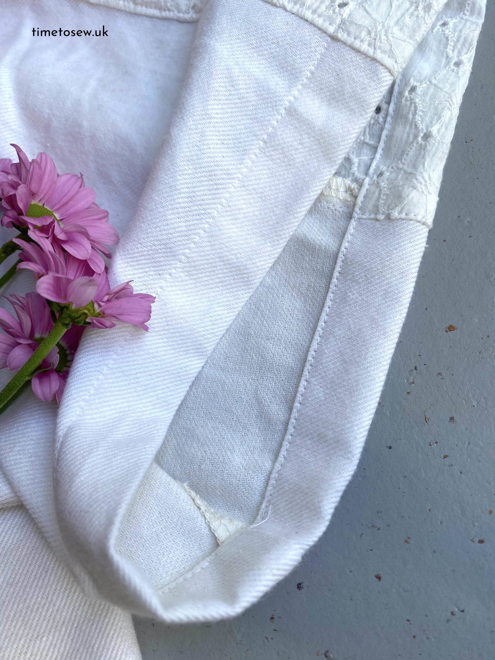 Close up of sleeve of Fibre Mood Aila, a white button down shirt.