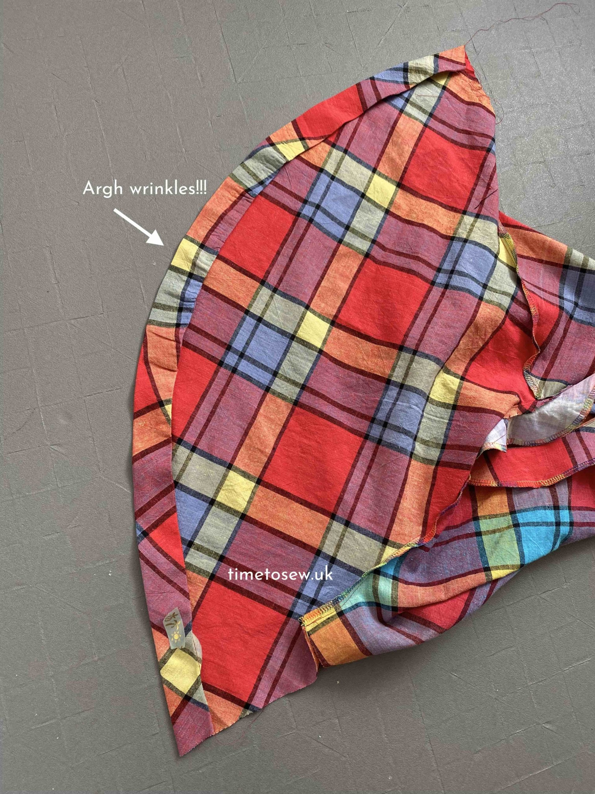 Sleeve piece from the Peppermint Paddington top in a checkered fabric