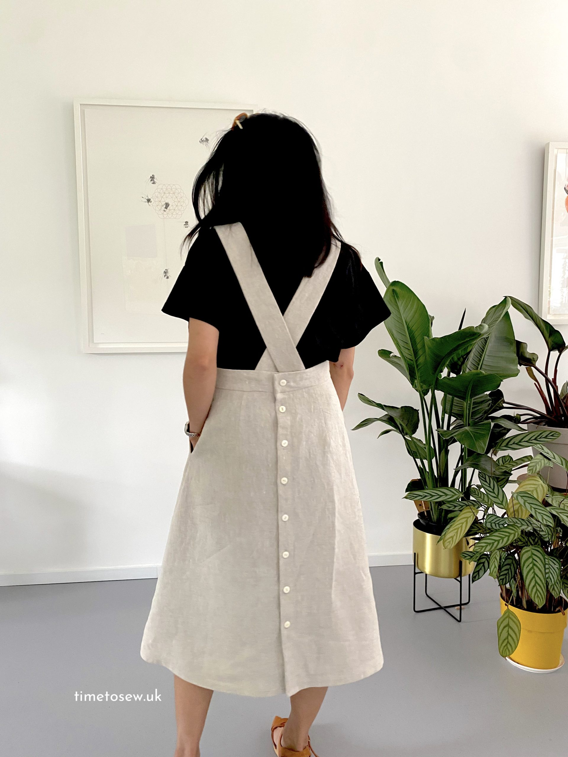 Peppermint Milton pinafore back view with button back skirt