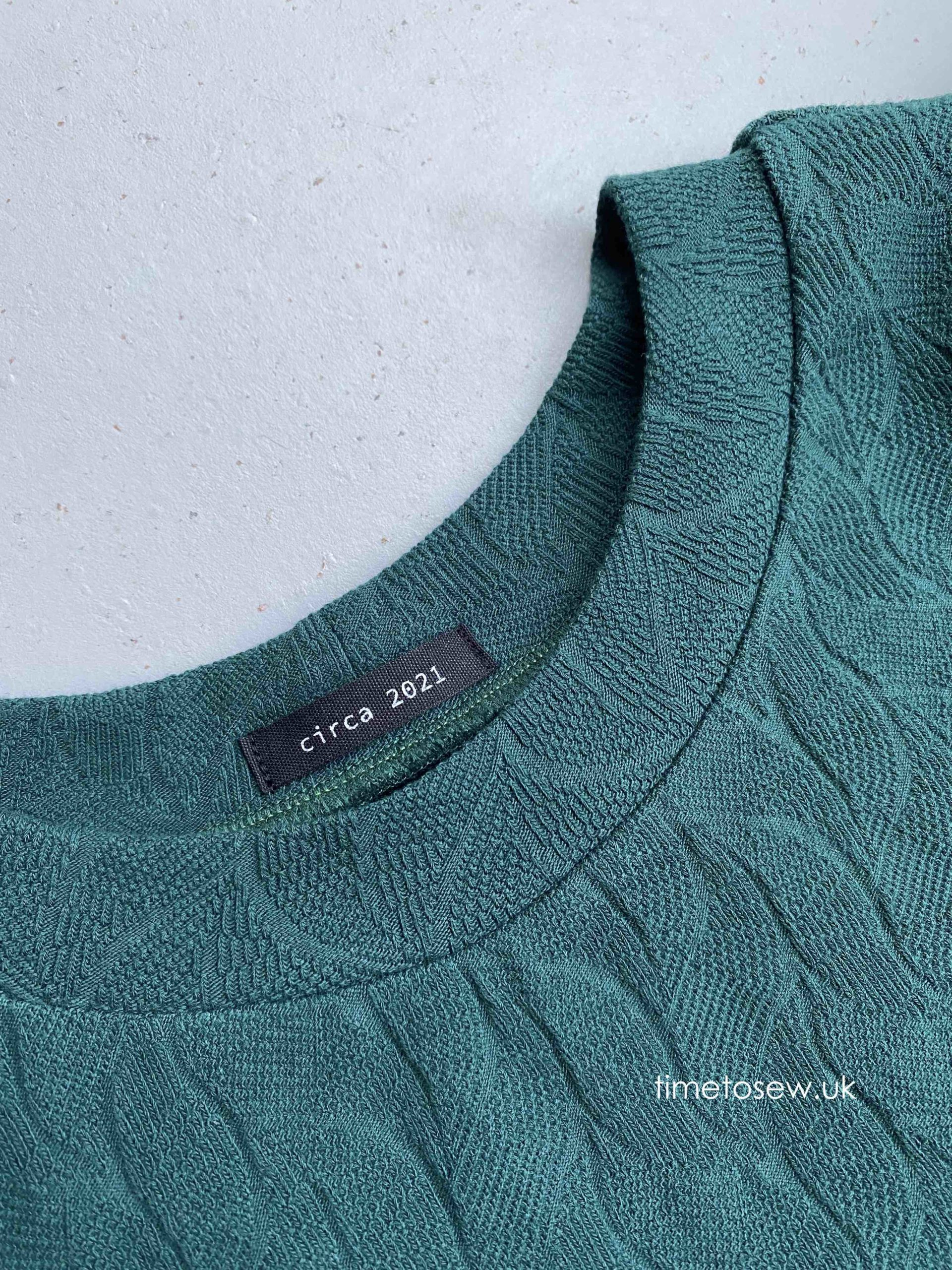 Neckline close up with 2021 label
